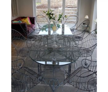 Four piece glass top table
